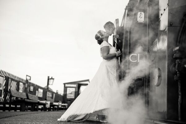 Bride and Groom Kiss on Steam Train