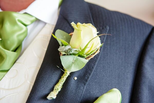 Groom's white rose buttonhole