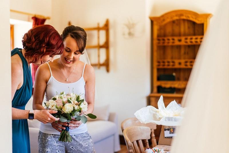Bride with their bridesmaid & bouquet