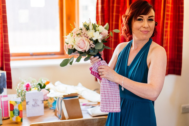 Bridesmaid drying her bouquet