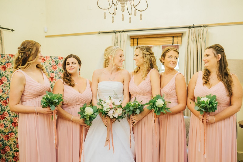 Bride with her bridesmaids before the ceremony
