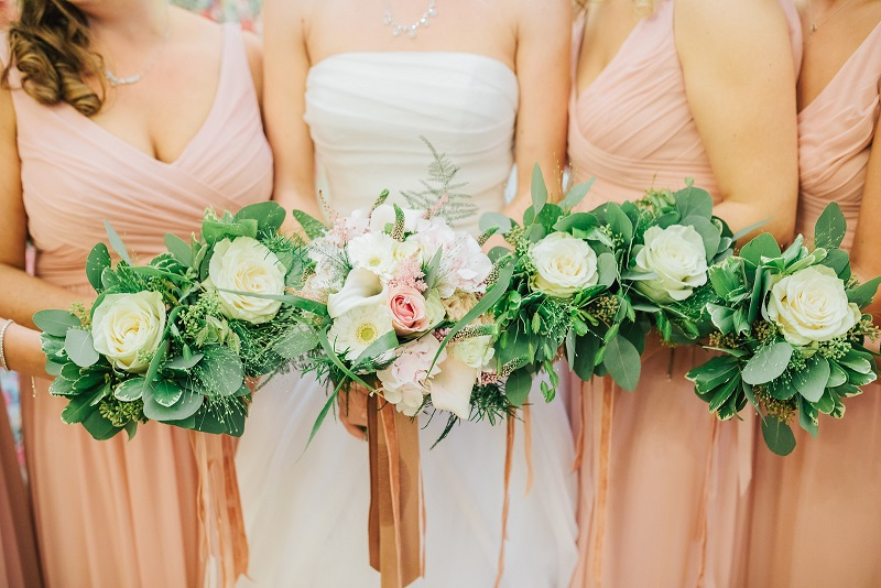 Close up of Bridal Bouquet and Bridemaids Bouquets in a row
