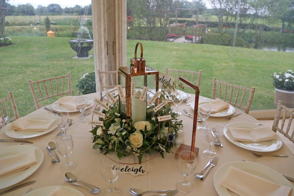 Wedding Flowers round table centrepiece with lantern.