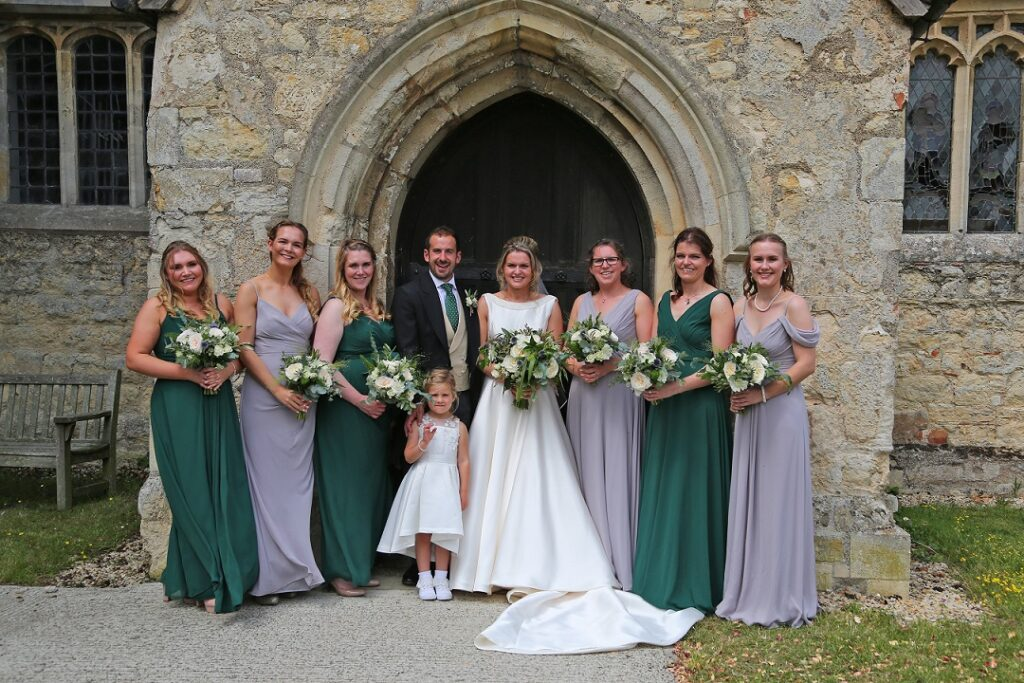 Bridal Party and Groom outside church.