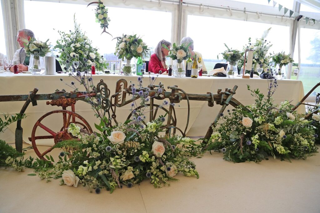 Top table rustic farm inspired floral display.