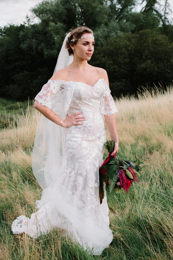 Model wearing Madi Lane Bridal Gown.