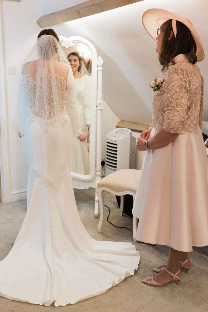 Bride seeing her reflection before her wedding