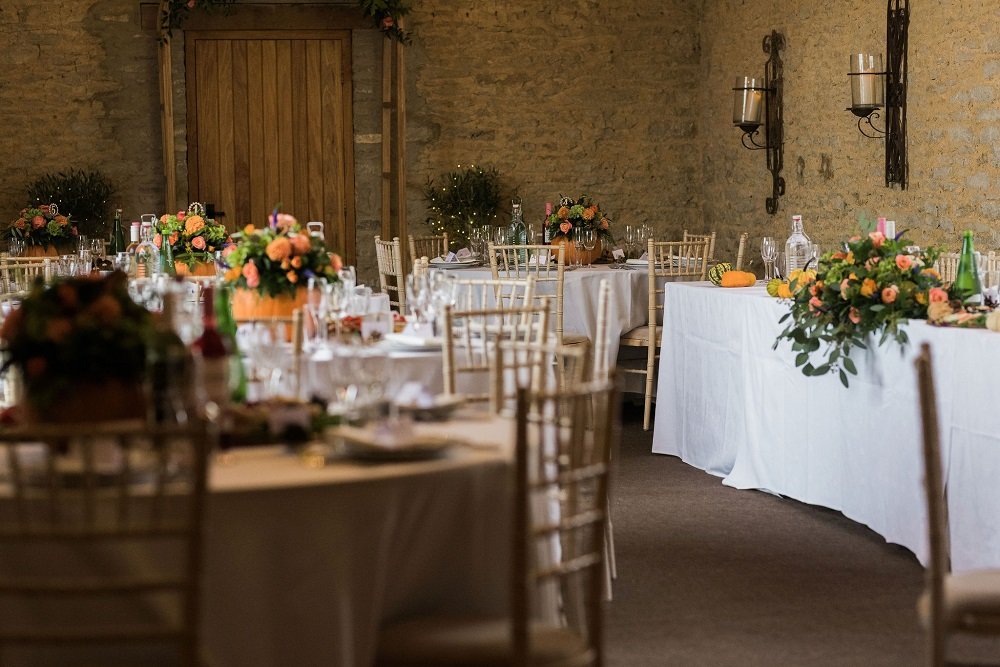 Pumpkin floral centerpieces and wedding reception decor Stratton Court Barn