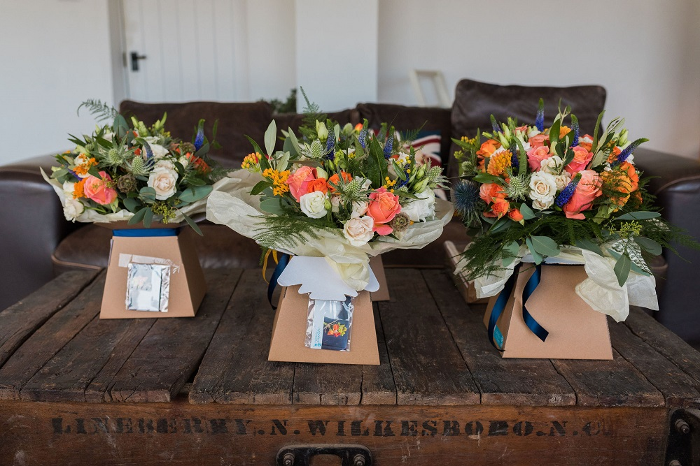 Orange, Navy and Peach Bridal and Bridesmaid Bouquets