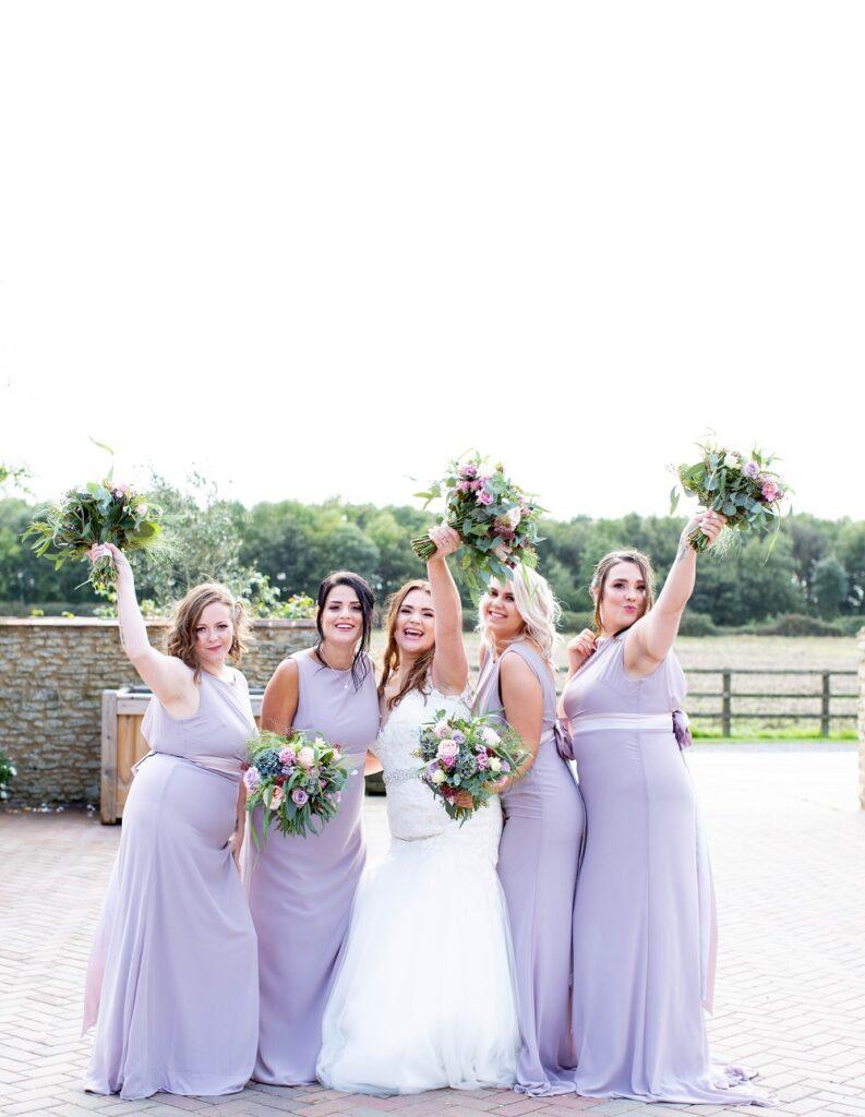 Bride and Bridesmaids in lilac.