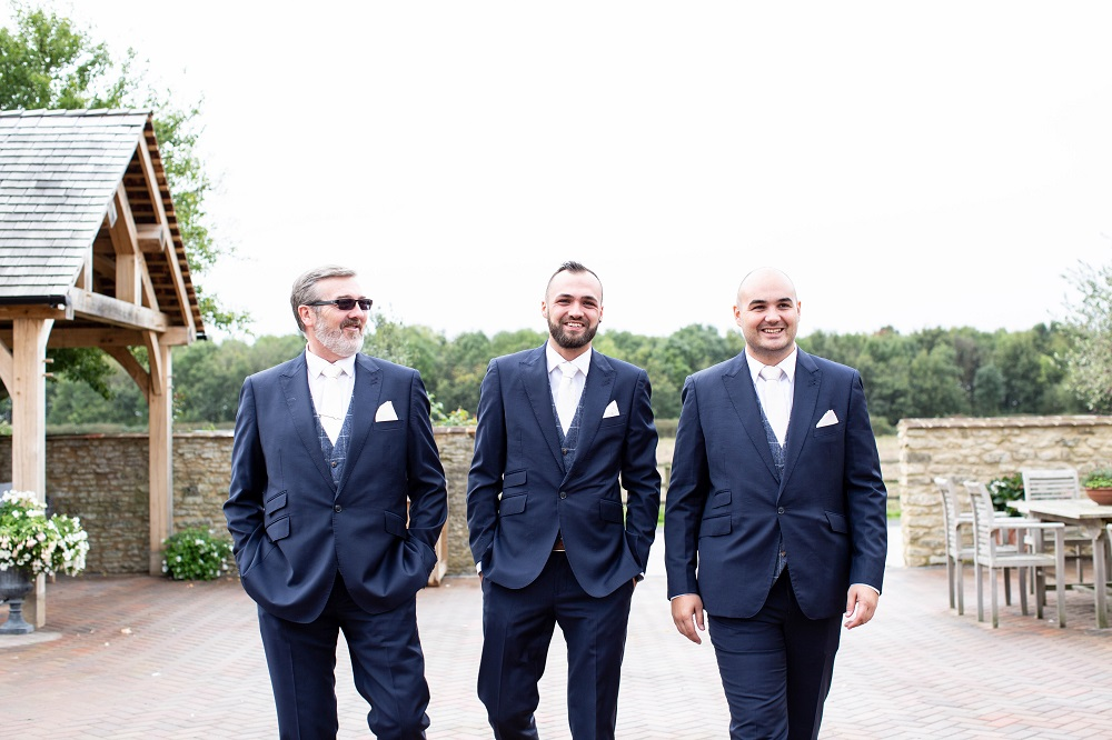 Goom and Groomsmen in navy suits.