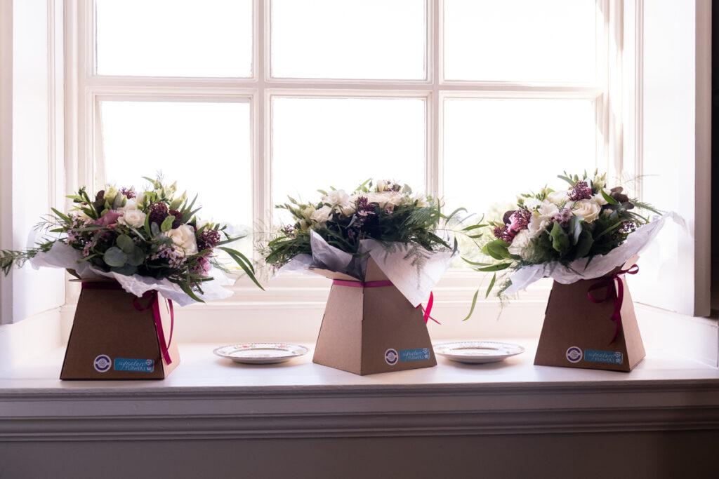 Bridesmaid bouquets on windowsill
