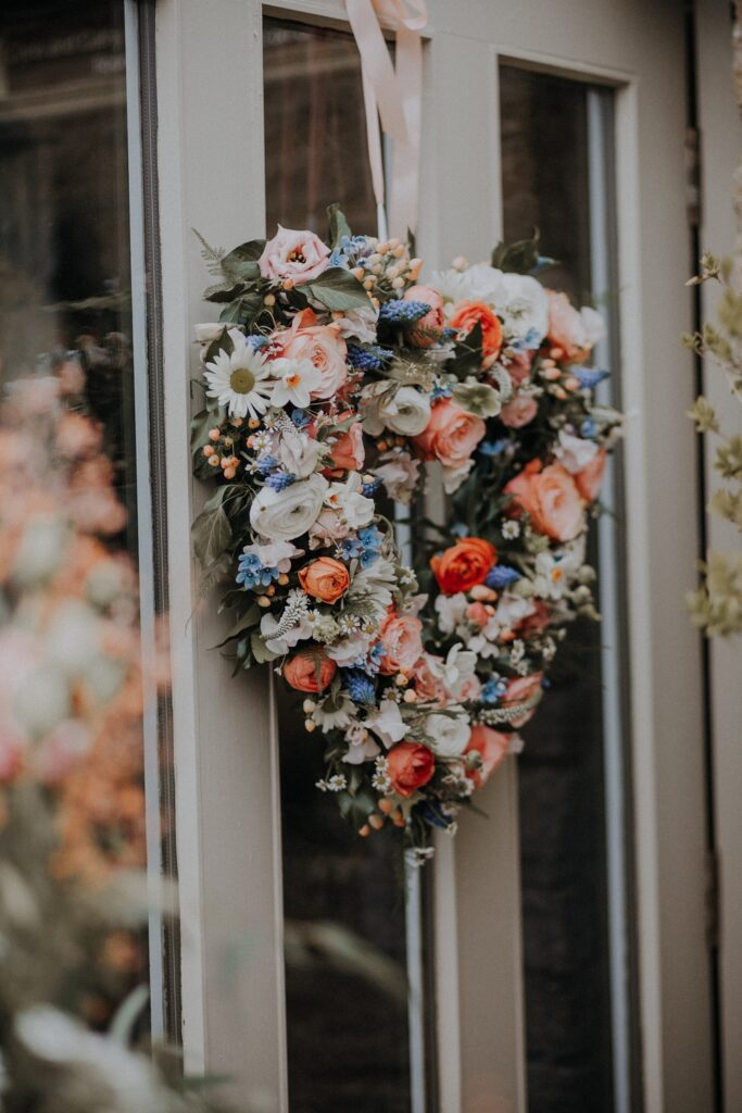 Close up of Floral heart wreath on door.