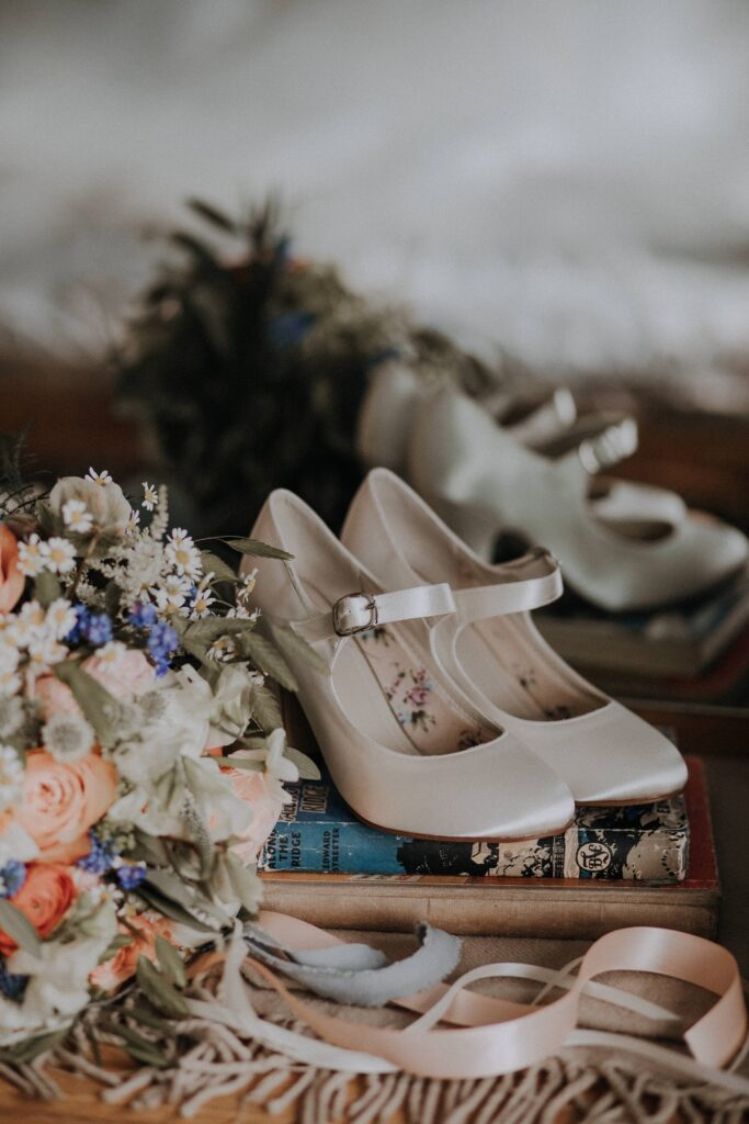 Bridal shoes and bouquet.