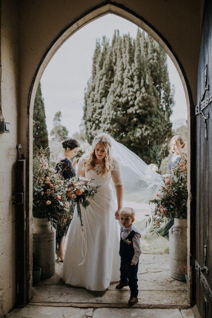 Bride entering church with Pageboy.