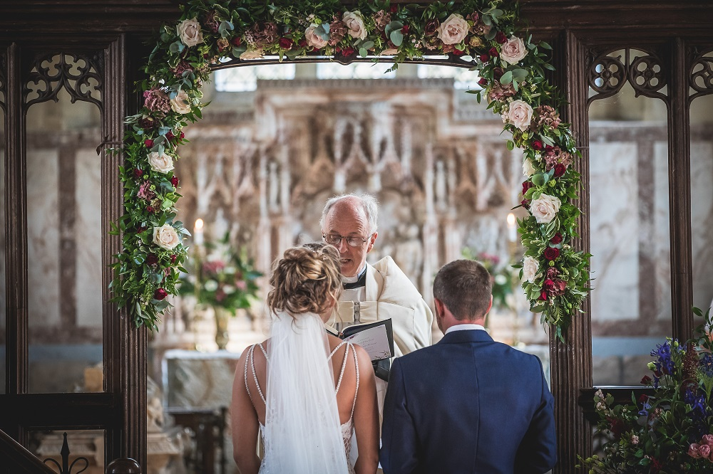 Bride and Groom saying their vows at the altar