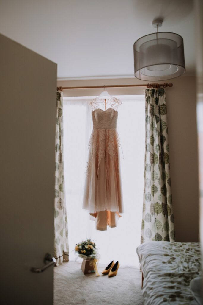 Wedding Dress hanging in bedroom window