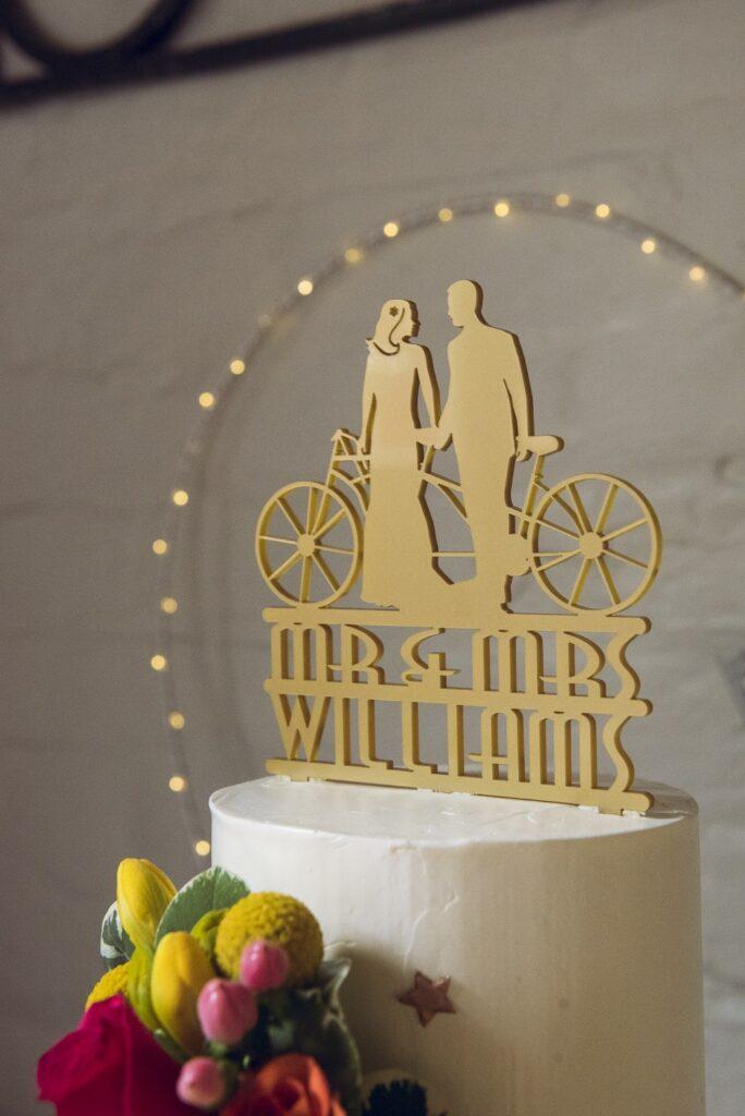 Close up of wedding cake topper.