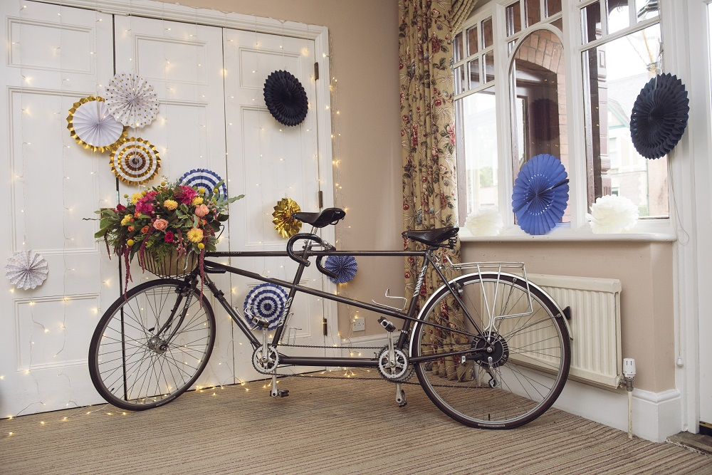 Tandem Bicycle with floral arrangement.