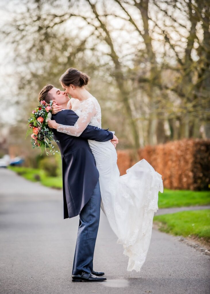 Groom picking up Bride